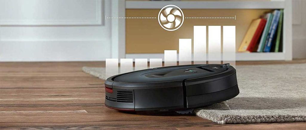 Un Roomba in azione su un tappeto